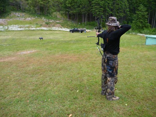 man aiming at a target
